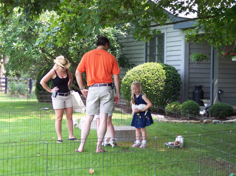 Family playing with Shorty Jacks in a fenced area